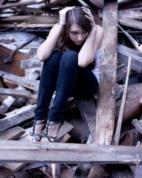 scared-girl-sits-on-ruins-1348272-m
